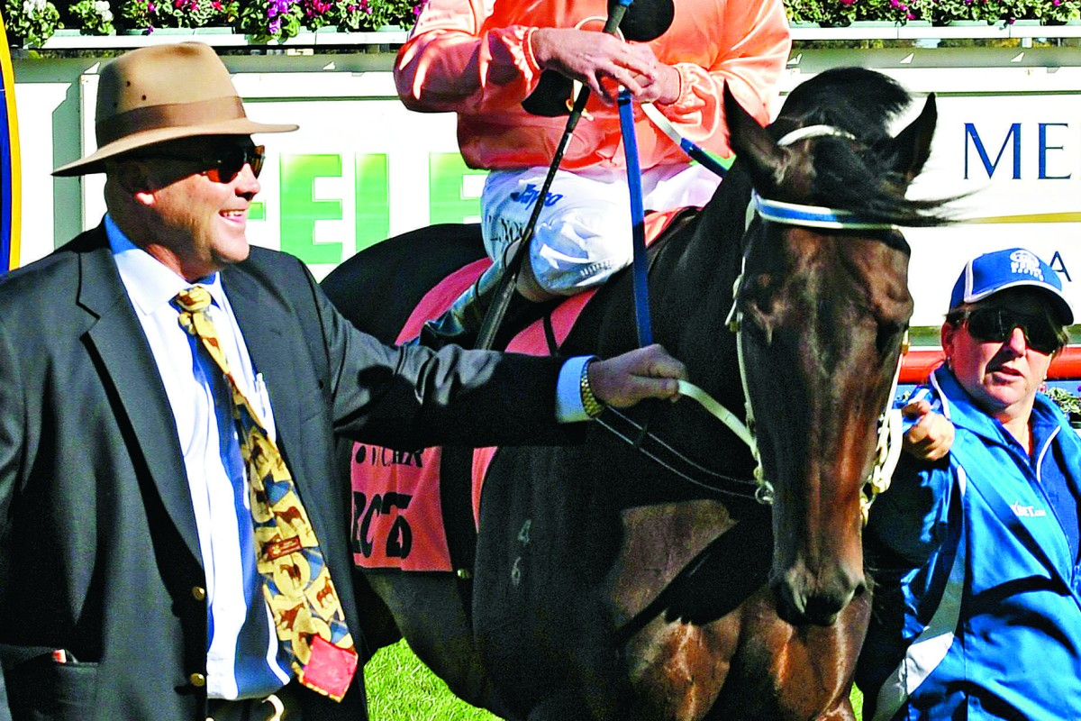 Trainer Peter Moody, pictured at the farewell to Black Caviar at Caufield in 2013, was found not guilty of giving any horse cobalt as a performance enhancer but his six month-ban came under the rule dealing with a trainer's responsibility to present a horse drug-free for racing. Photo: AFP