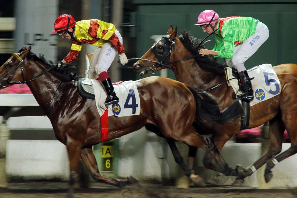 French jockey Olivier Doleuze stands up in the stirrups as he passes the winning post aboard Our Folks in the final race of the night at Sha Tin. Photos: Kenneth Chan