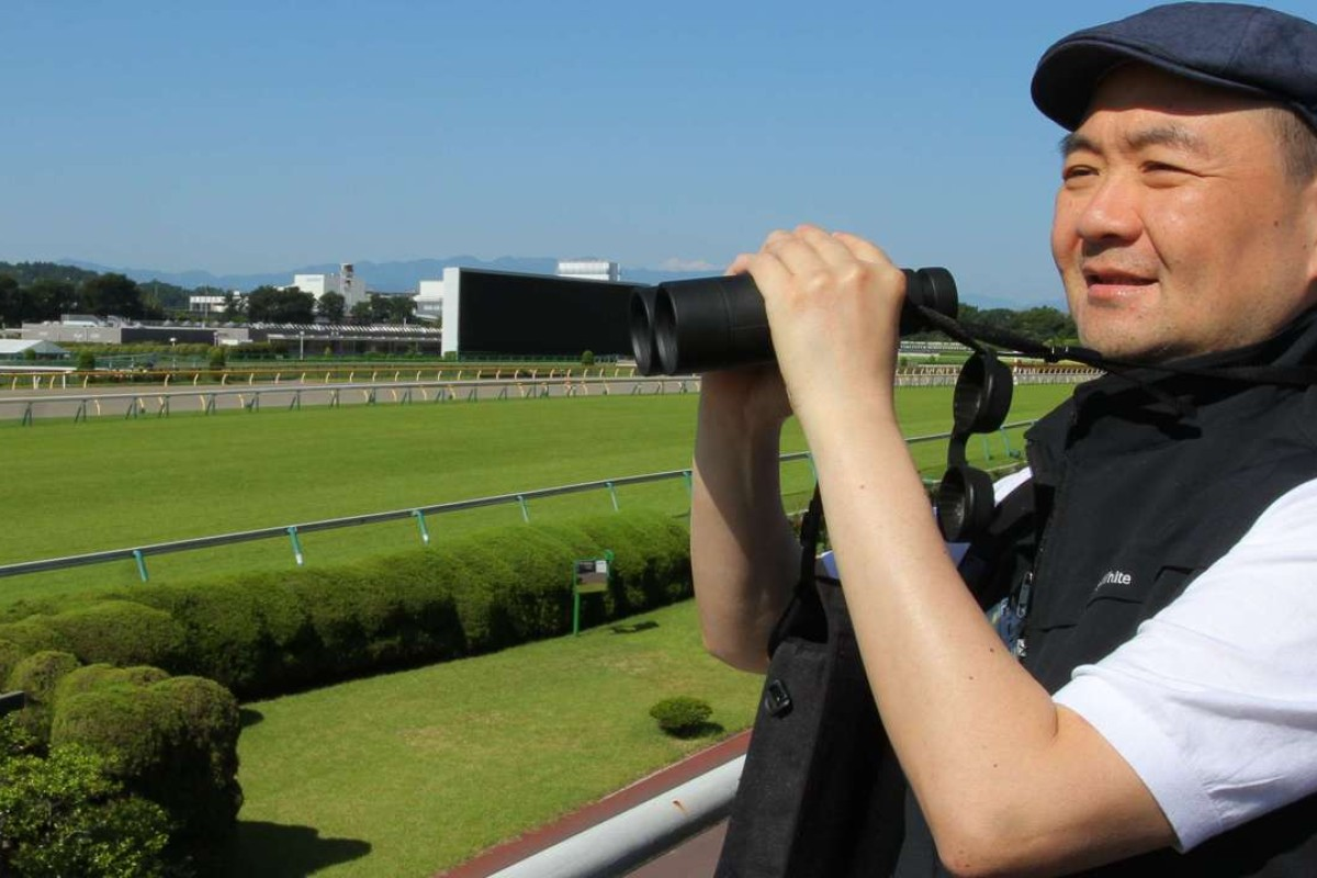 Benson Lo Tak-wing watches his horse, Contentment, complete his final gallop for Sunday's Yasuda Kinen at Tokyo Racecourse. Photos: Kenneth Chan