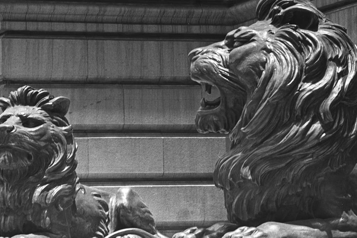 The bronze lions guarding the HSBC headquarters in Central still bear war wounds from 1941.