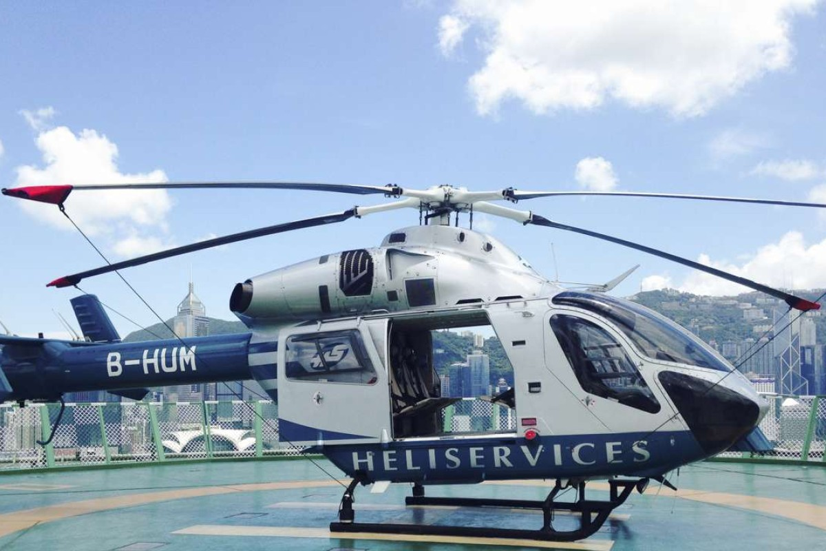 The helicopter used for Viator's tour of Hong Kong, parked on the roof of The Peninsula hotel, in Tsim Sha Tsui. Pictures: Rachael Barker