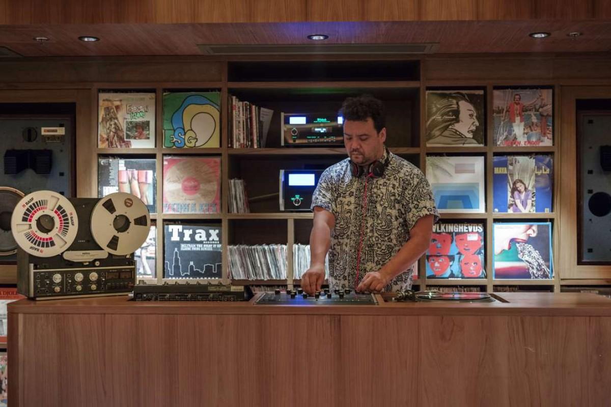 Johnny Hiller (top) DJs at the music room.