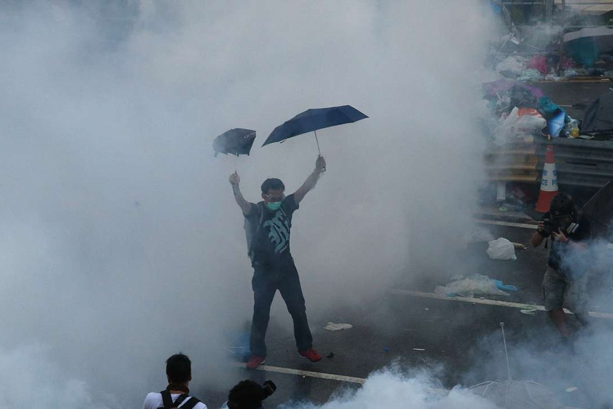 The police fire tear gas at protesters on Harcourt Road in Admiralty, Hong Kong, during Occupy Central. The movement will have enhanced Beijing's suspicion and its determination to cut Hong Kong down to size. File photo