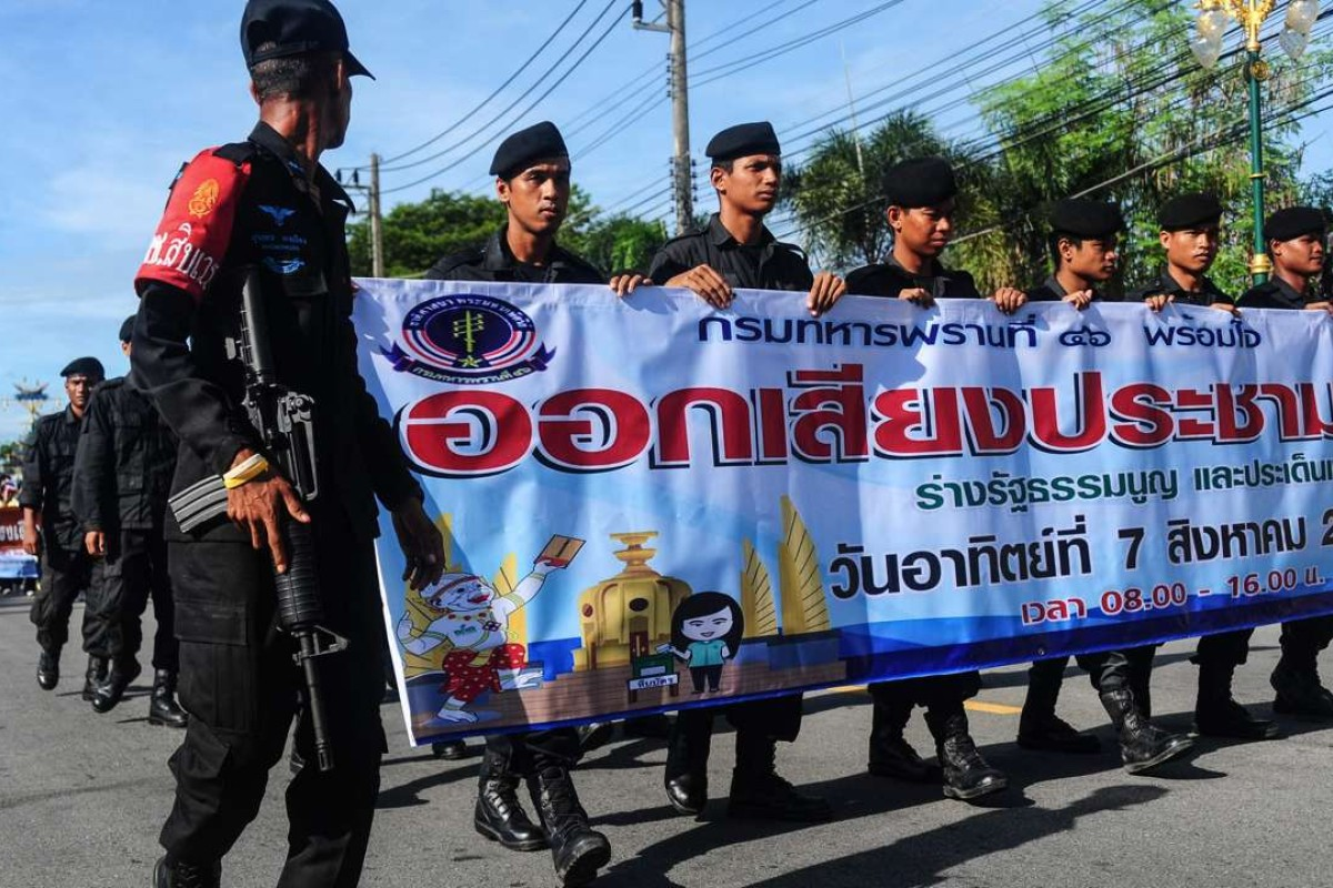 Thai soldiers march as part of a campaign encouraging the public to vote in the referendum on Thailand's draft constitution. Photo: AFP