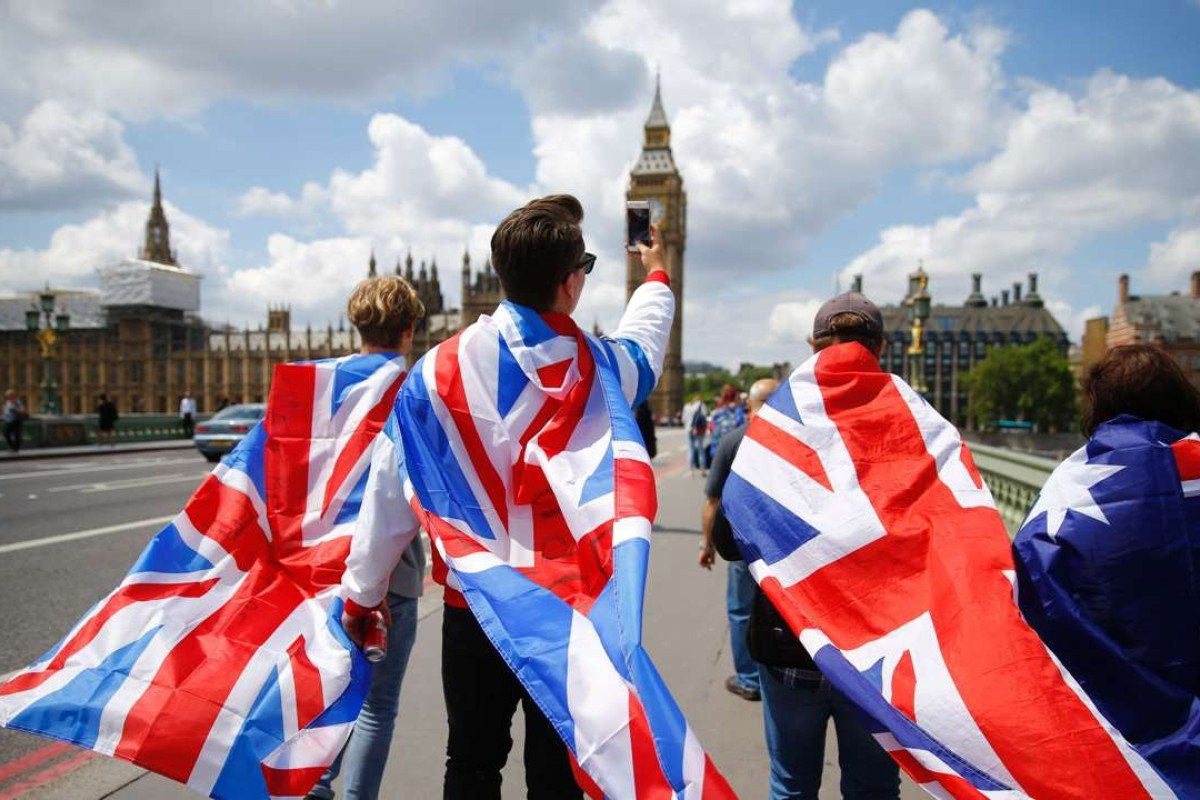 People walk over Westminster Bridge wrapped in Union flags following Britain's Brexit vote. Photo: AFP