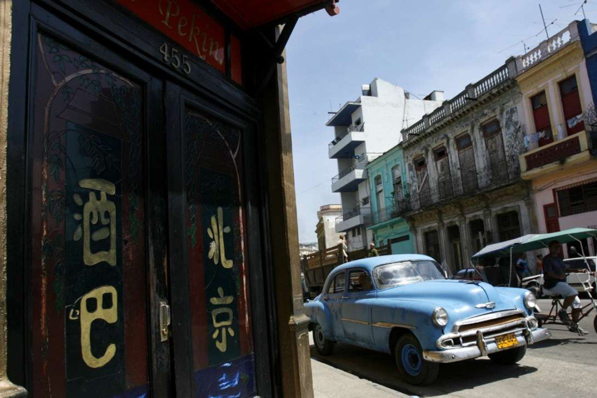 A vintage car is parked outside a Chinese restaurant in Havana's Chinatown. Photo: Reuters