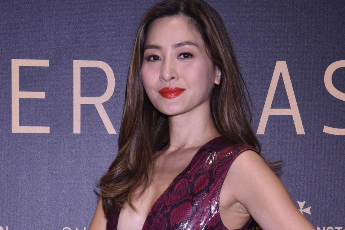 Kathy Chow looking sexy in this plunge-neck dress at Vacheron Constantin Overseas Exhibition