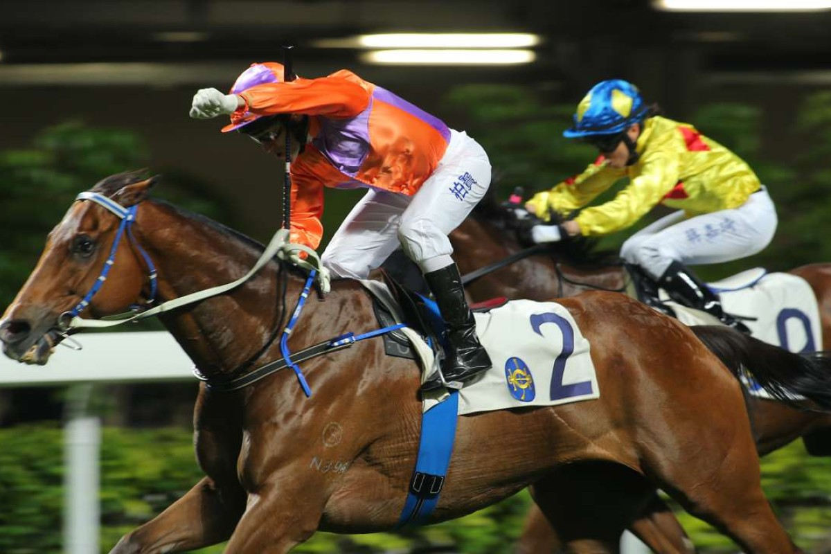 Brett Prebble salutes the crowd after prevailing on Royal Partner for trainer Caspar Fownes. Photos: Kenneth Chan