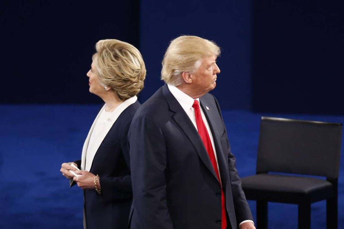 Republican Donald Trump and Democrat Hillary Clinton during the second presidential debate at Washington University in Missouri. Photo: Bloomberg