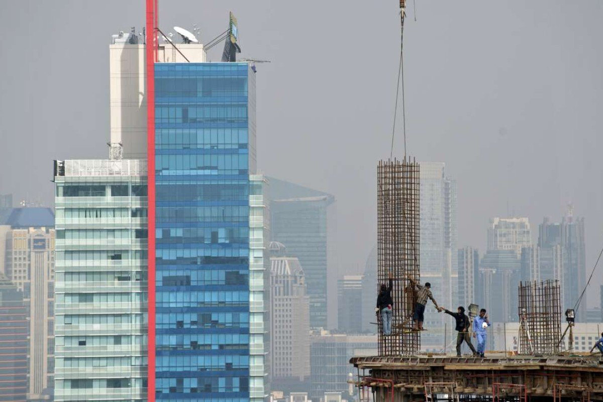 Jakarta is expanding upwards – but what is life like for those who are building it? Photo: AFP