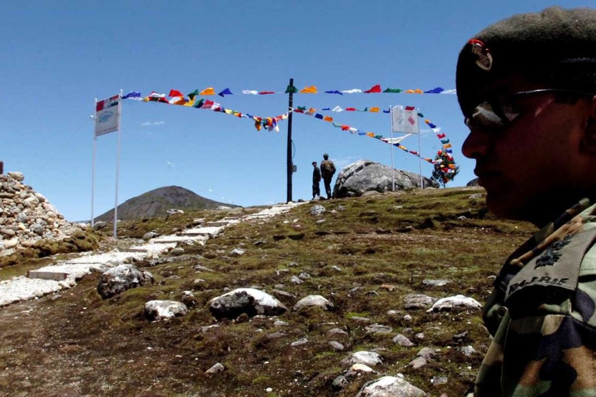 An Indian army major watches Indian post at a 15,500ft high mountain pass on the McMahon Line, about 47km from Tawang, in Bumla, Arunachal Pradesh. Photo: AFP
