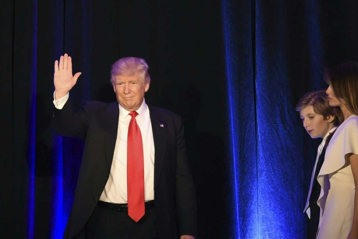 Republican presidential candidate Donald Trump waves from the balcony flanked by members of his family shortly before addressing supporters at the New York Hilton Midtown. Photo: AFP