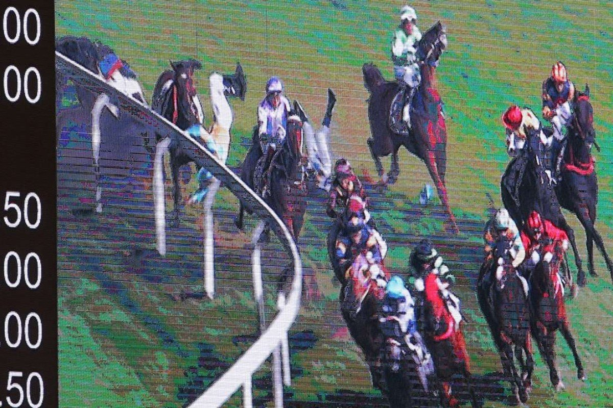 Umberto Rispolo and Jack Wong hit the turf in a nasty fall at Happy Valley last week.