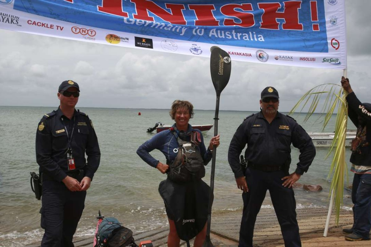 Australian adventurer Sandy Robson after coming ashore on the island of Saibai in the Torres Strait at the end of her journey.