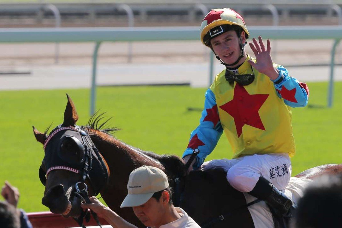 Oisin Murphy waves to the crowd after notching his first Hong Kong victory with Happy Agility at Sha Tin on Sunday. Photos: Kenneth Chan