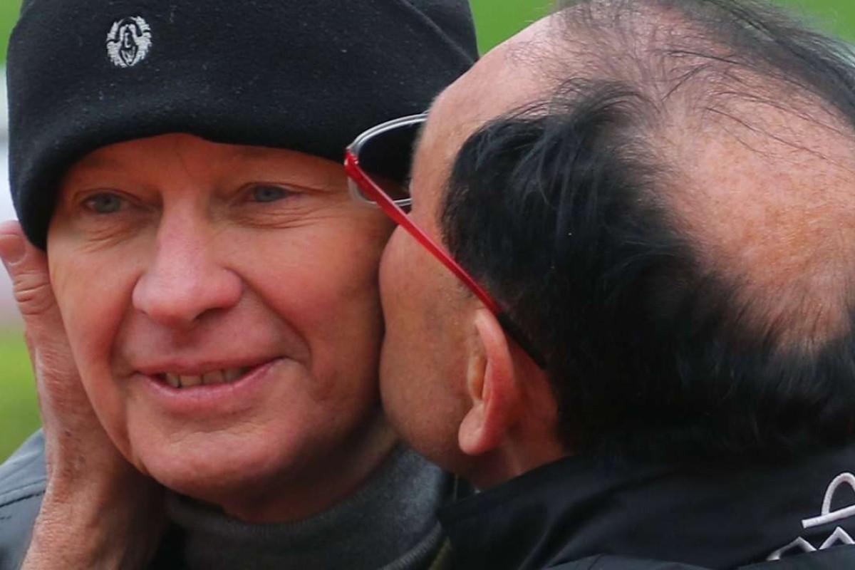 Gary Moore plants a kiss on his brother John's cheek. Photos: Kenneth Chan