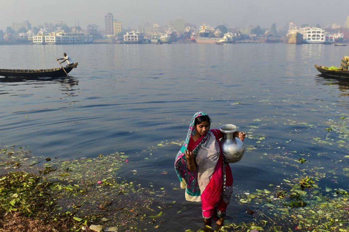 A Bangladeshi woman collects water from a river in Dhaka. The advent of tube wells appeared to have given rural Bangladeshis a source of clean water, but there was a major drawback - arsenic. Photo: AFP