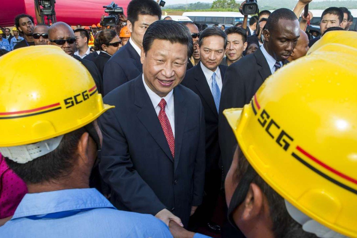 China's President Xi Jinping shake hands with Chinese construction workers in Port-of-Spain, Trinidad and Tobago. His latest trip to the region is his third since taking office in early 2013, when this photo was taken. Photo: AFP