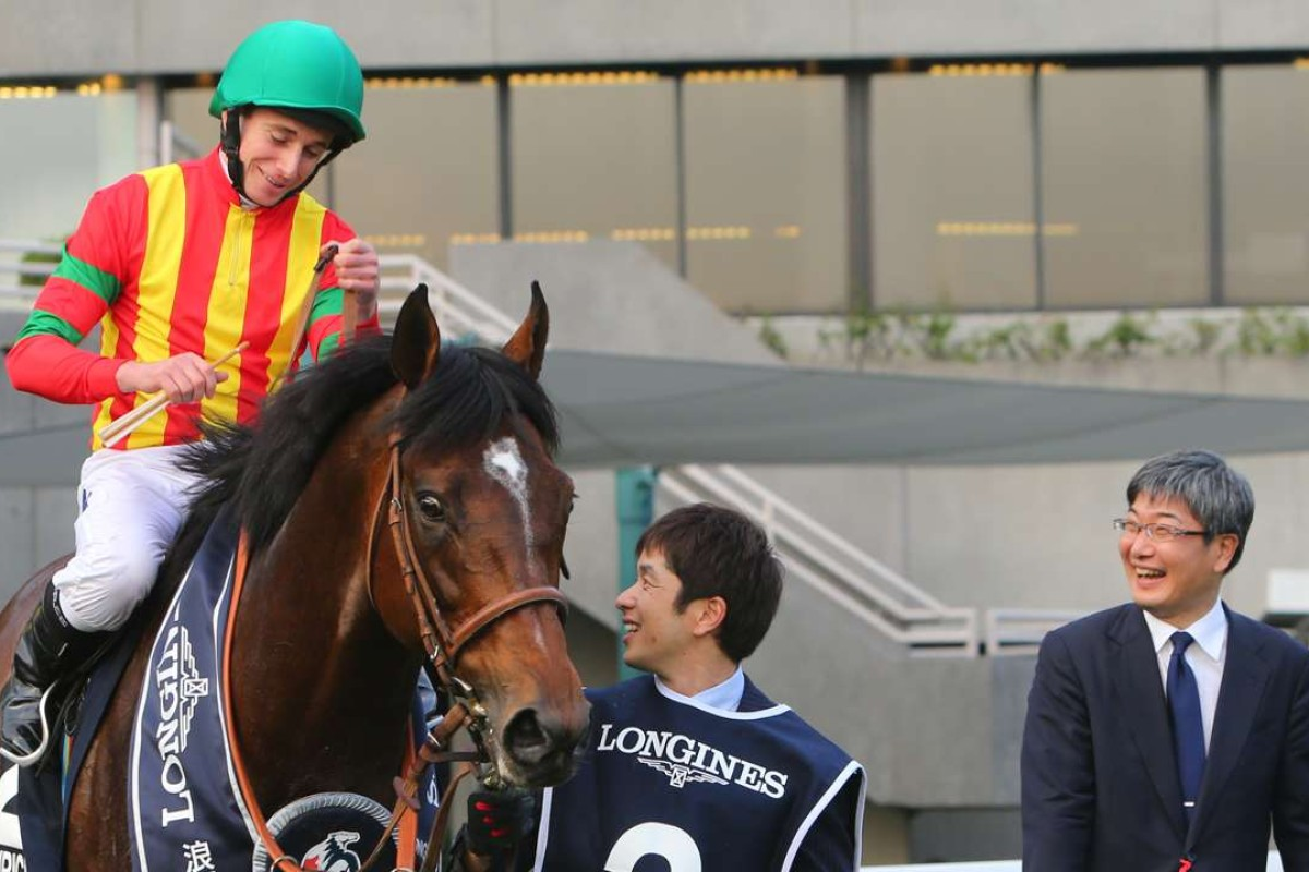 Ryan Moore talks to trainer Noriyuki Hori after Maurice's Longines Hong Kong Cup victory. Photo: Kenneth Chan