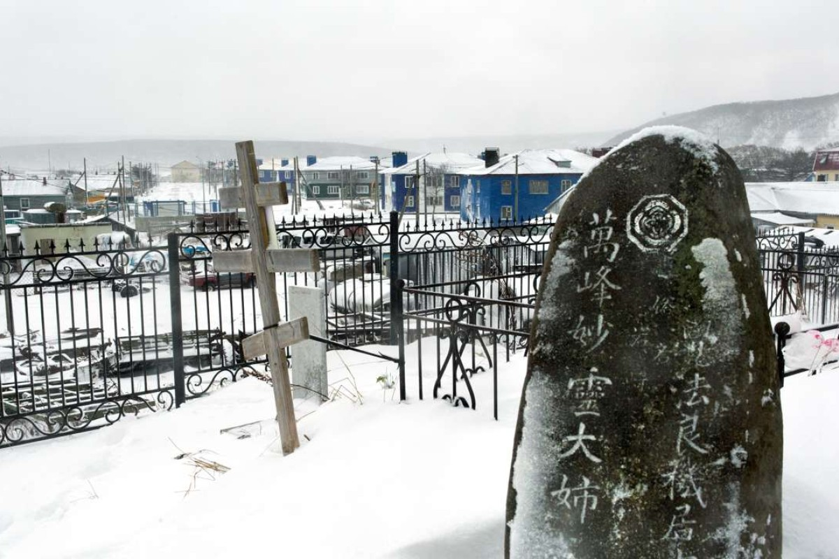 A Russian Orthodox cross next to a Japanese gravestone at a cemetery outside Kurilsk town on the island of Iturup in the Kurils. Photo: AFP