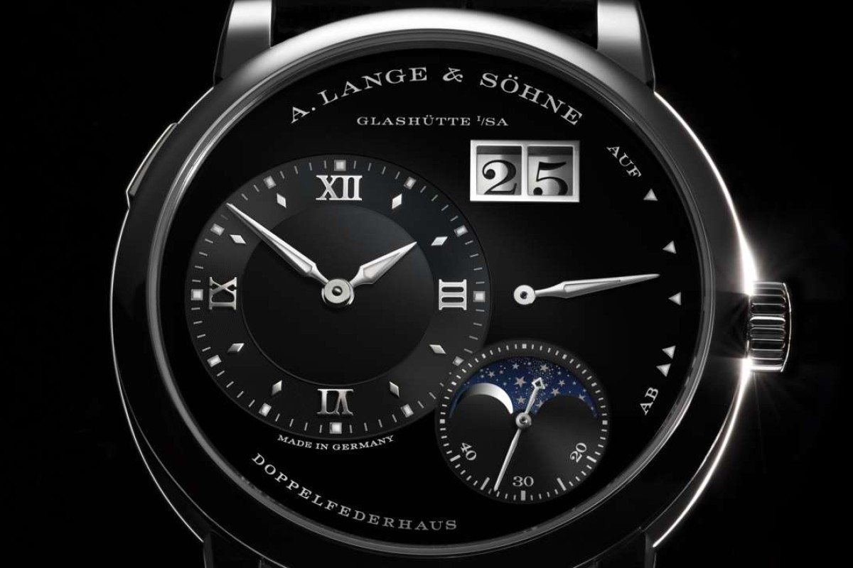 The Lange 1 Moon Phase is available in white gold/black, pink gold/argente, platinum/rhodie case/dial combinations.