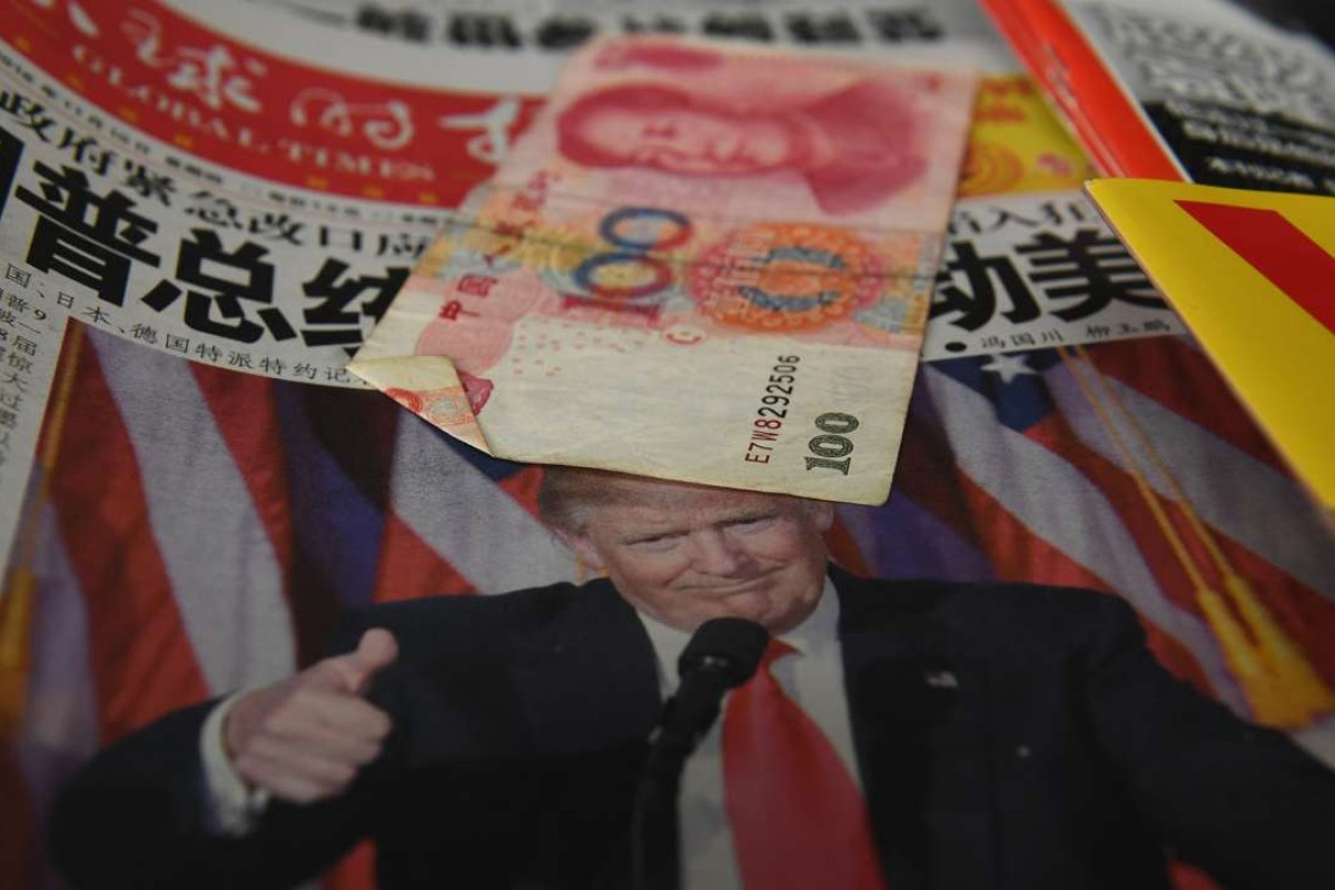 """A Chinese newspaper featuring a photo of US president-elect Donald Trump that reads """"President Trump shakes America"""". Photo: AFP"""