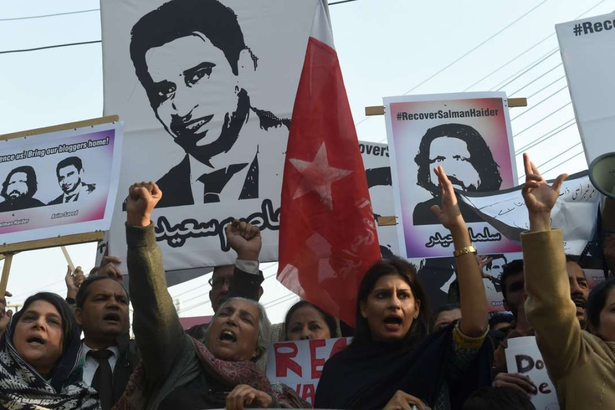 Pakistani rights activists hold images of bloggers who have disappeared, during a protest in Lahore on January 12. Photo: AFP
