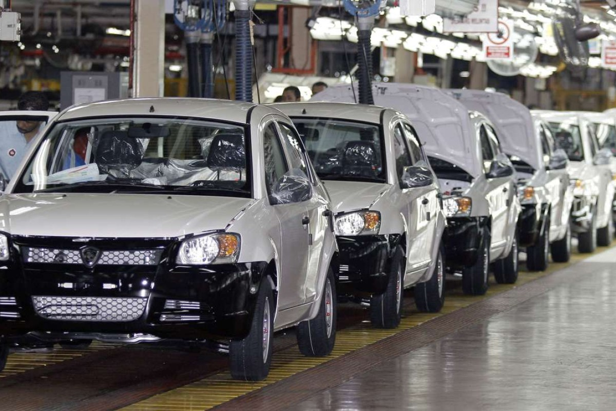 Proton Saga cars on the assembly line in Shah Alam. Malaysia's former prime minister, Mahathir Mohamad, called the car a 'symbol of Malaysians as a dignified people'. Photo: AFP