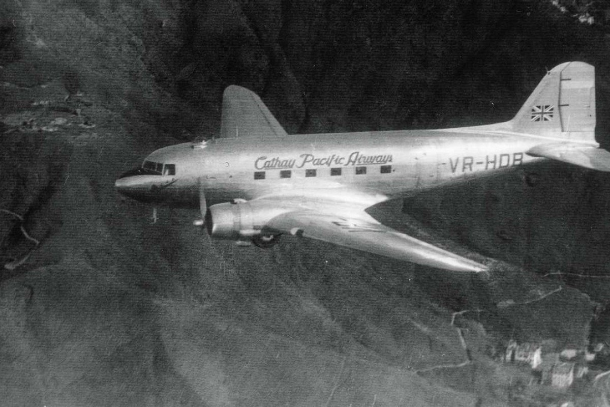 A Cathay Pacific DC-3 passenger aircraft in the air over Hong Kong in the late 1940s. Picture: Cathay Pacific Airways