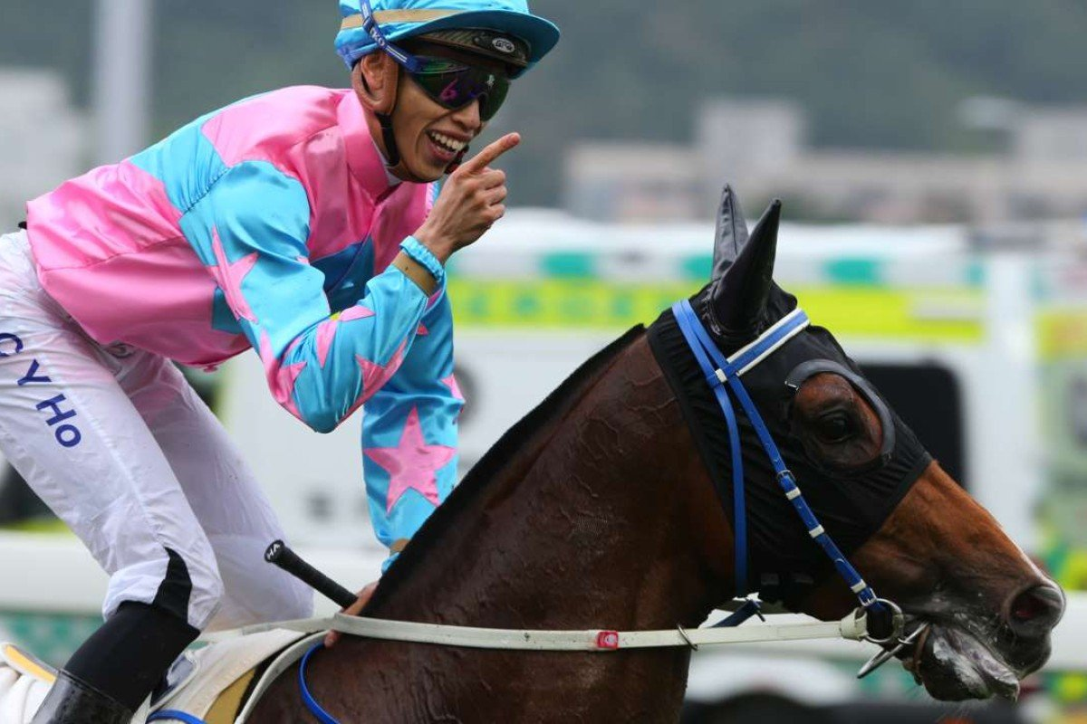 Vincent Ho is all smiles after guiding Apache Spirit to win at 100-1. Photos: Kenneth Chan