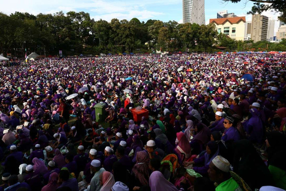 A rally in Kuala Lumpur calls for elements of a strict Islamic penal code to be adopted. Photo: Reuters
