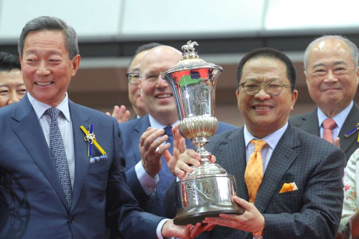 Jockey Club Chairman Simon Ip Sik-on (left) presents the Hong Kong Derby trophy to Werther's owner Johnson Chen. Photos: Kenneth Chan