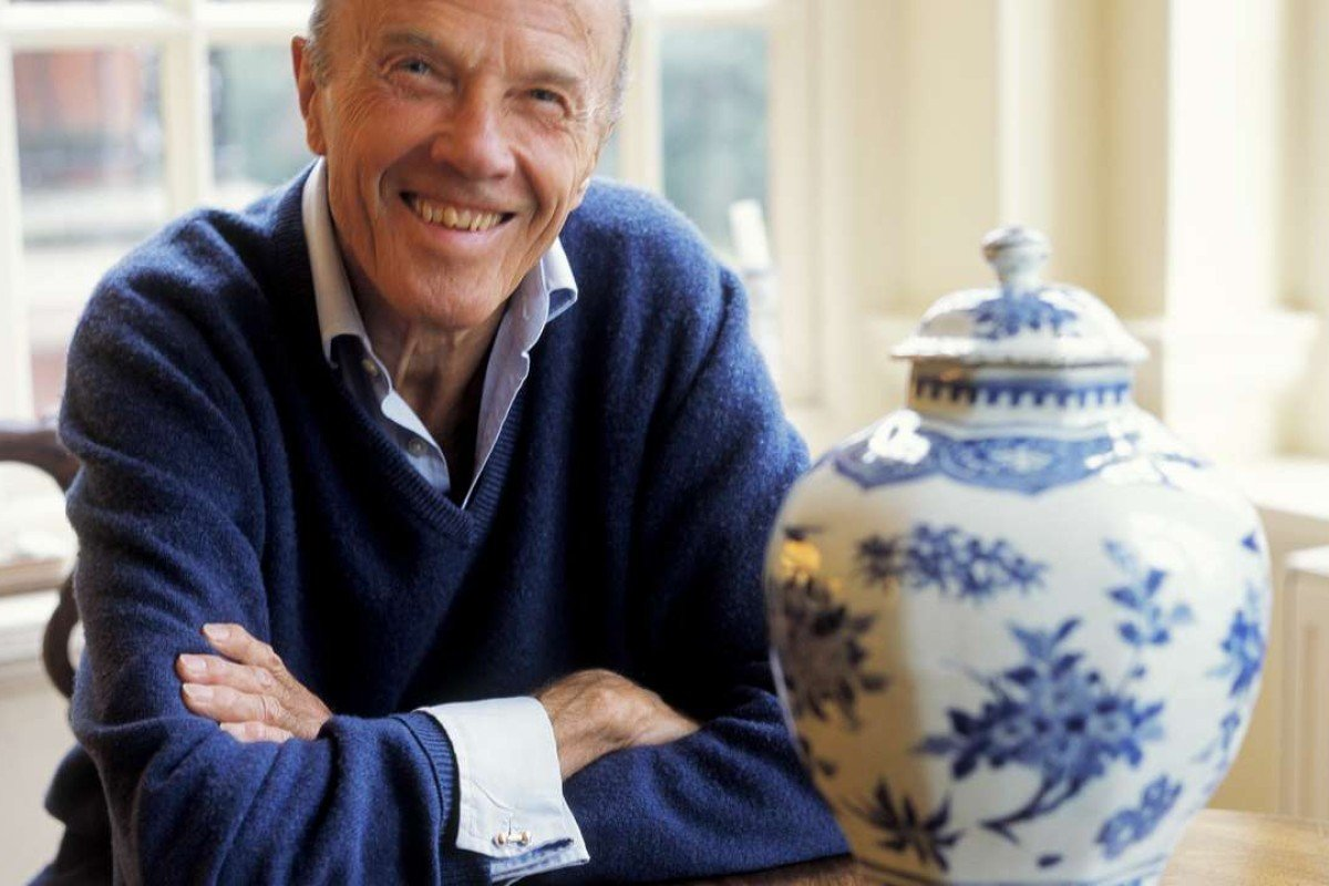 The late Sir Michael Butler with a 17th-century Chinese ceramic octagonal jar from his collection. Picture: courtesy of Katharine Butler