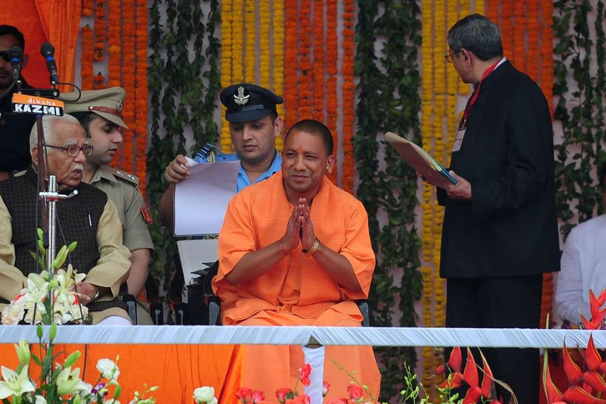 Yogi Adityanath, centre, Uttar Pradesh's new chief minister, at his swearing-in ceremony in Lucknow. Photo: AFP