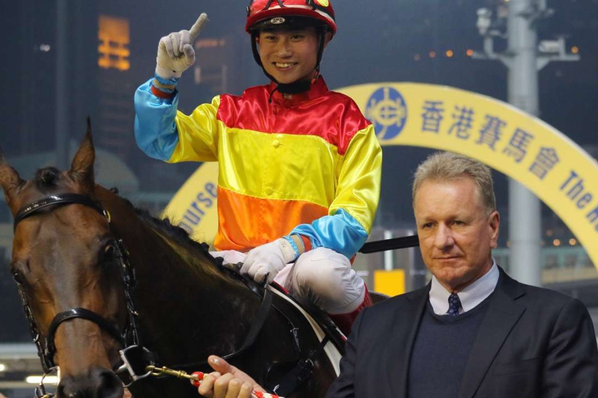 Dylan Mo and Tony Millard pose for the cameras after Travel Comforts' win at Happy Valley on Wednesday night. Photos: Kenneth Chan