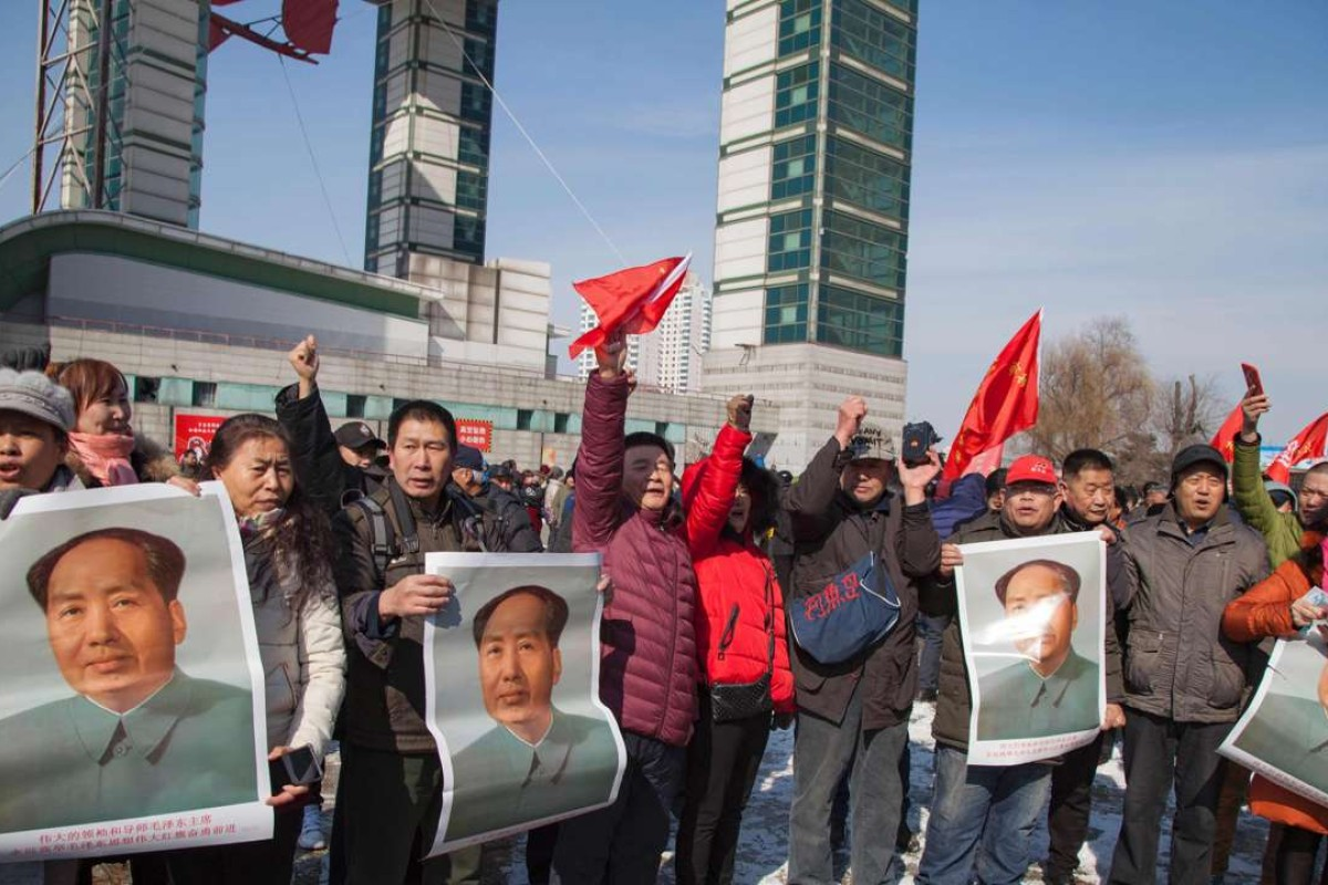 Chinese protesters hold Mao Zedong posters as they call for a boycott of South Korean goods in Jilin. Photo: AFP
