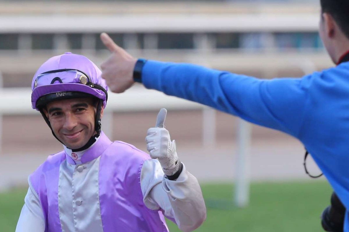 Joao Moreira gives the thumbs up to a fan after General Sherman's win at Sha Tin on Sunday. Photos: Kenneth Chan