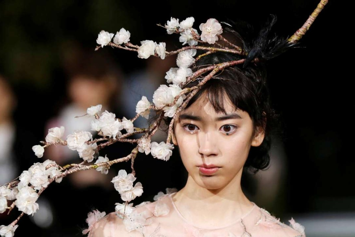Christian Dior's spring-summer 2017 haute couture collection by Italian designer Maria Grazia Chiuri on the rooftop garden of the Ginza Six new retail complex in Tokyo. Photo: REUTERS