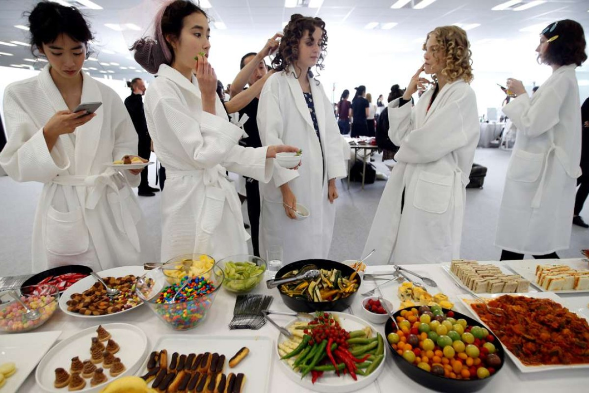 Models eat backstage at Christian Dior's spring-summer 2017 haute couture show at Ginza Six. Photo: REUTERS/Toru Hanai