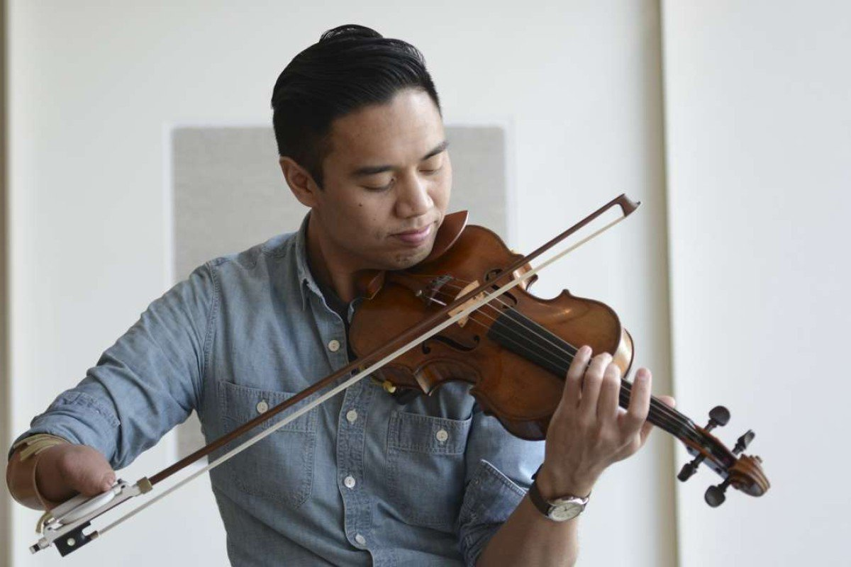 Disability shifts when you give people the right tools to overcome challenges, says Thai-Chinese violinist Adrian Anantawan, who was born without fingers on his right hand. Picture: Antony Dickson