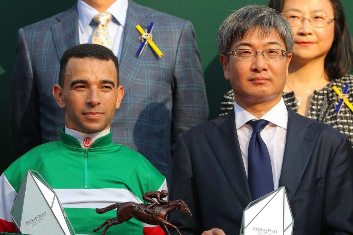 Joao Moreira and Noriyuki Hori collect their QE II Cup trophies. Photos: Kenneth Chan