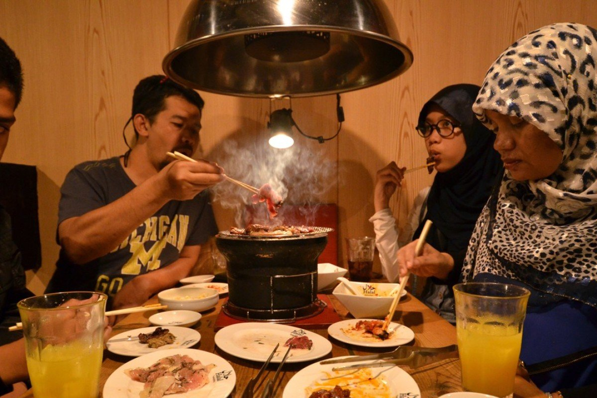 Thai Muslim tourists enjoy halal certified food at a barbecue restaurant in Tokyo. Photo: AFP