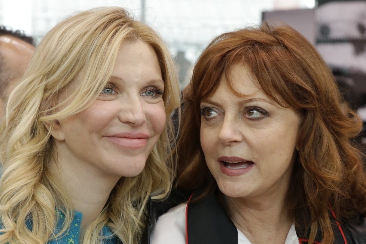 Actress Susan Saradon, right, is flanked by singer Courtney Love prior to the start of the women's Prada Cruise mid season collection, first ever runway show. Photo: AP