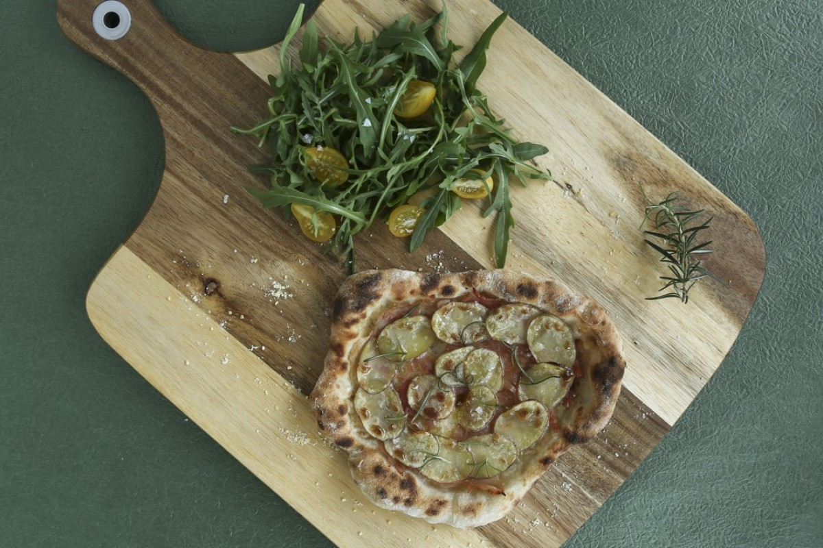 Pizza with potato, ham and rosemary. Photography: Jonathan Wong. Stylist: Nellie Ming Lee