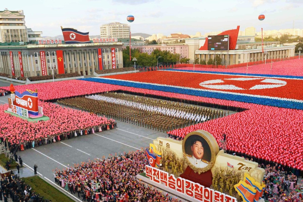 North Korean Citizens March Following A 2015 Military Parade In Kim Il Sung  Square, Pyongyang