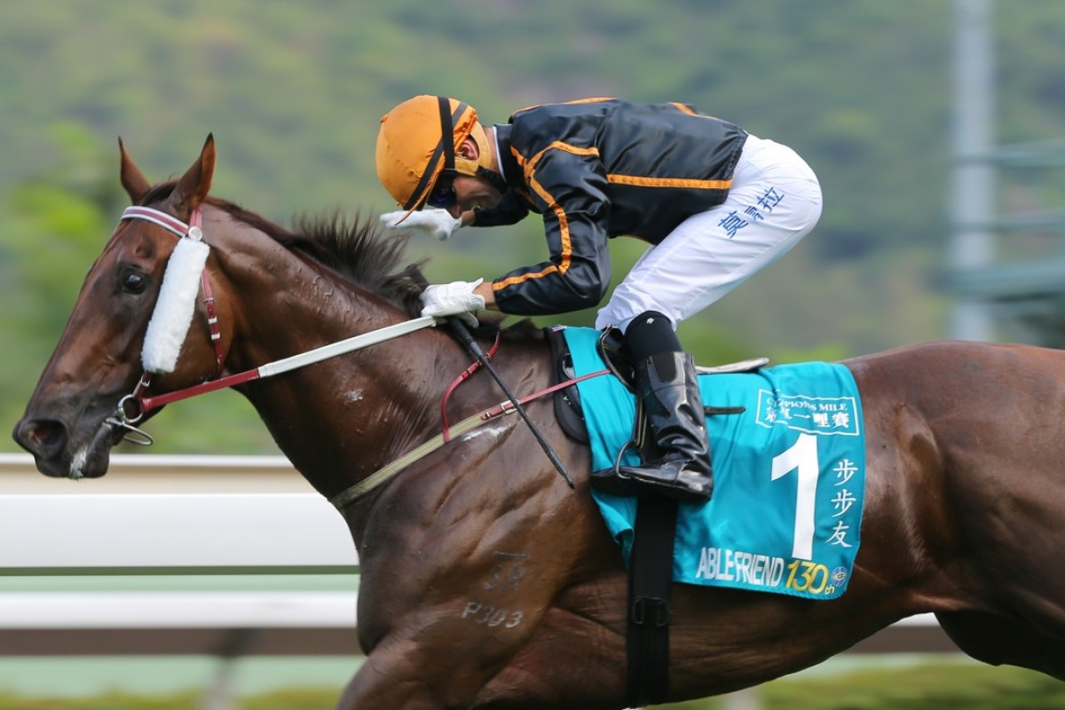 Joao Moreira pats Able Friend after winning the 2015 Champions Mile. Photo: Kenneth Chan