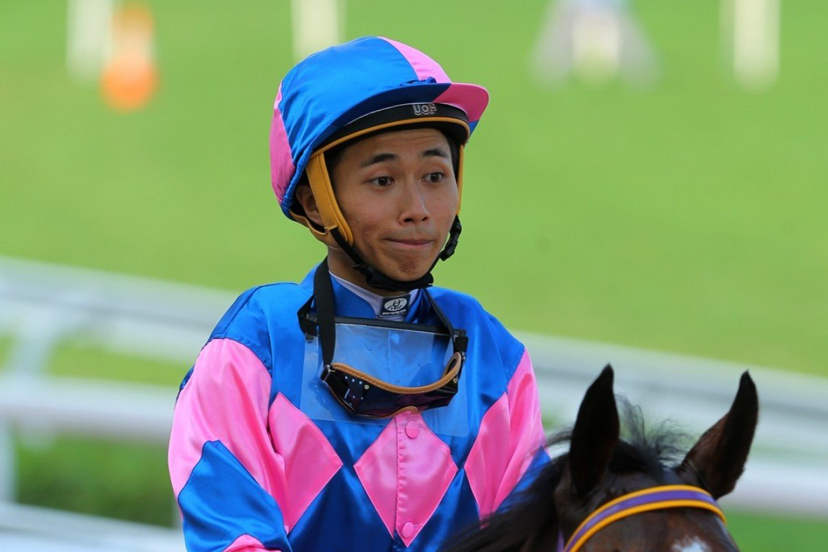 Matthew Poon returns to scale after his 12th winner of the season on Sunday at Sha Tin aboard Perpetual Treasure. Photos: Kenneth Chan