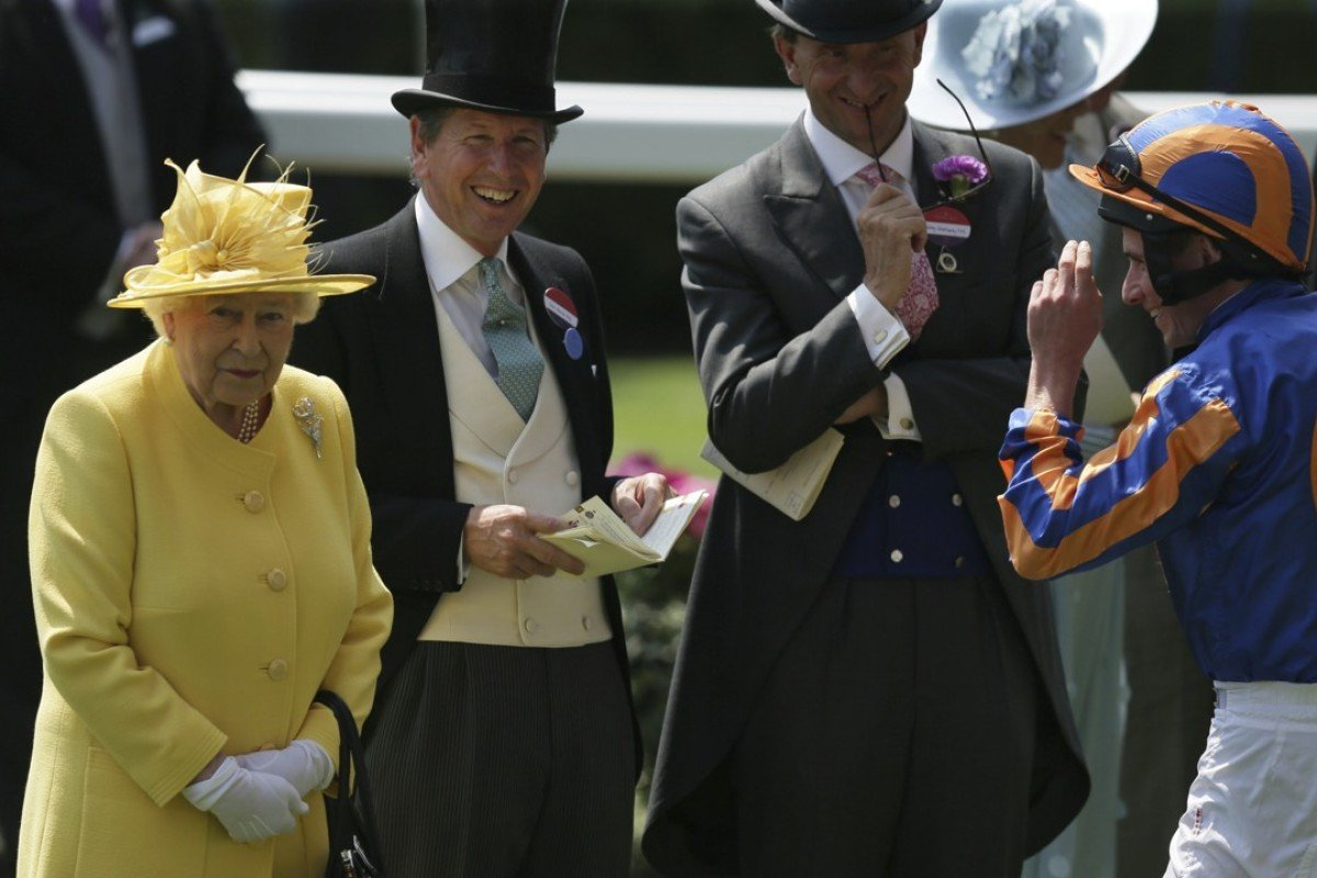 Britain's Queen Elizabeth II speaks with jockey Ryan Moore (right) and racing manager John Warren (1second left— after arriving in the parade ring on the second day of the Royal Ascot meeting. Photo: AP Photo/Tim Ireland