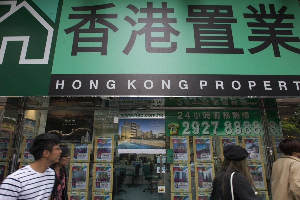 A real estate agent shop in Tsim Sha Tsui, Hong Kong. Is the city about to experience a property crash? Photo: EPA