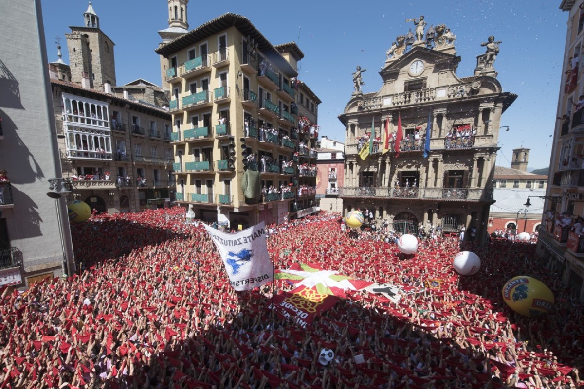 Participants in Pamplona's city hall square await the launch of the rocket that marks the start of the San Fermin Festival. Picture: AFP